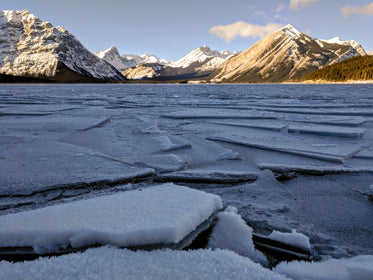sheets of ice formed on a frozen lake