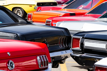 shiny bumpers and lights of vintage cars