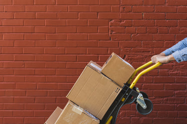 shipping boxes on red brick