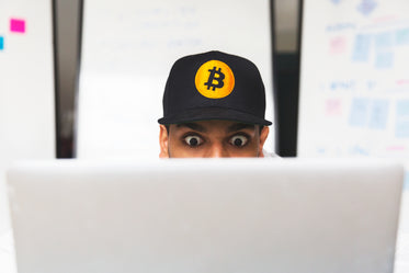shocked bitcoin investor on laptop