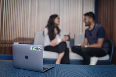 shopify laptop at small meeting