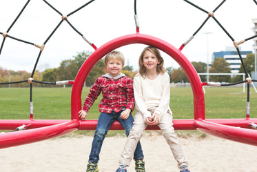 Free Siblings Smiling At Park Photo — High Res Pictures