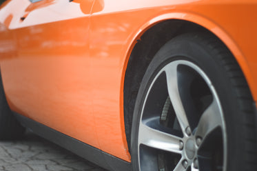 side view of an orange sports car