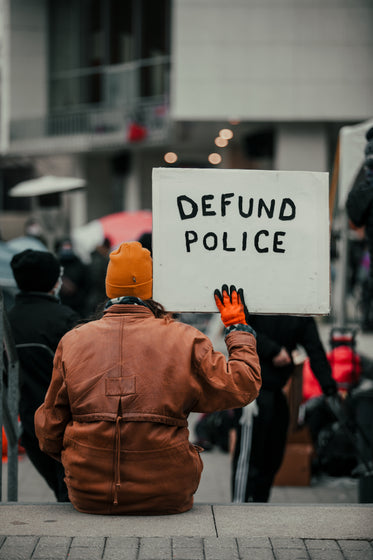 sign saying defund the police