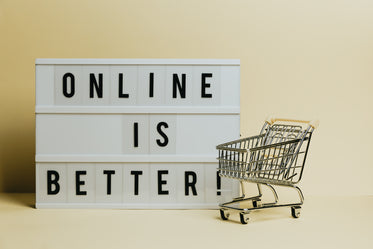 sign says online is better with a small shopping cart