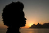 silhouette of a person with sunset behind them