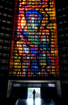 silhouette with a stained glass window above