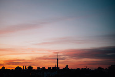 silhouetted berlin city skyline at sunset