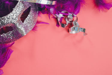 silver party mask on pink