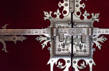 silver wrought locks against a blood red door
