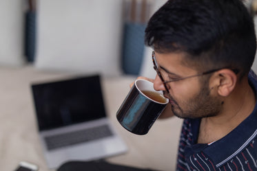 sipping tea in modern workspace