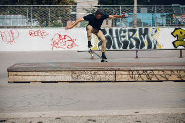 skateboarder doing an ollie onto grind box