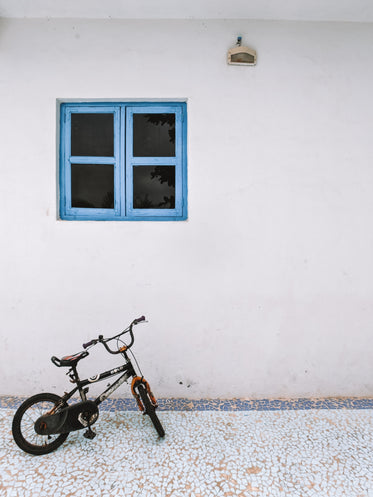 small bike under blue window frame