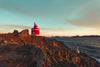 small red lighthouse in the rocks