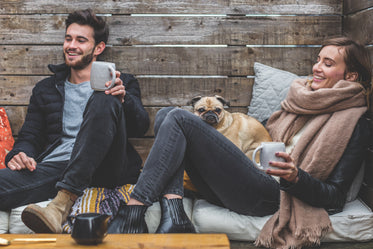 smiling man woman pug