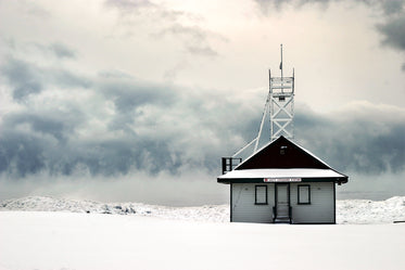 snow covered lifeguard station