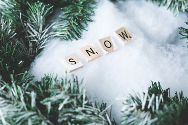 snow letter tiles with winter greens