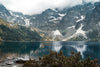 snowy mountains and a blue lake