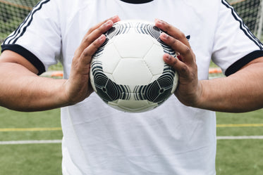 soccer ball in athletes hands