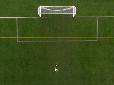 soccer player in penalty kick position drone view