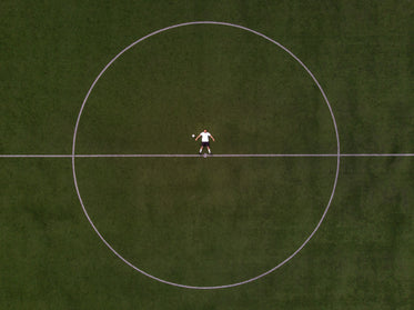 soccer player laying in the center circle