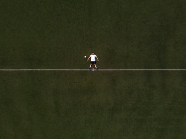 soccer player laying in the center line