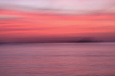 soft gradient of sunset over water