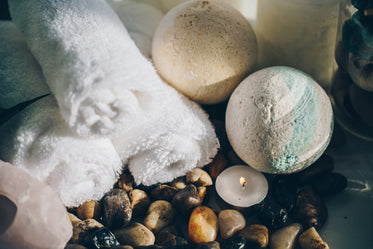 spa candle towel and stones