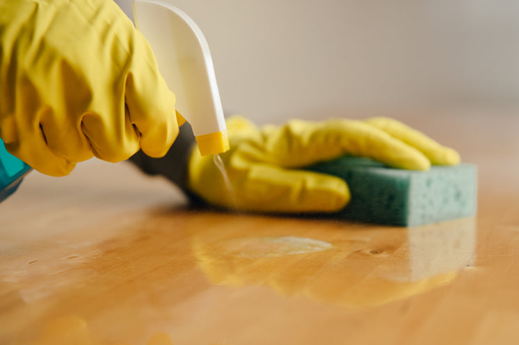 Spaying Cleaner On Wood