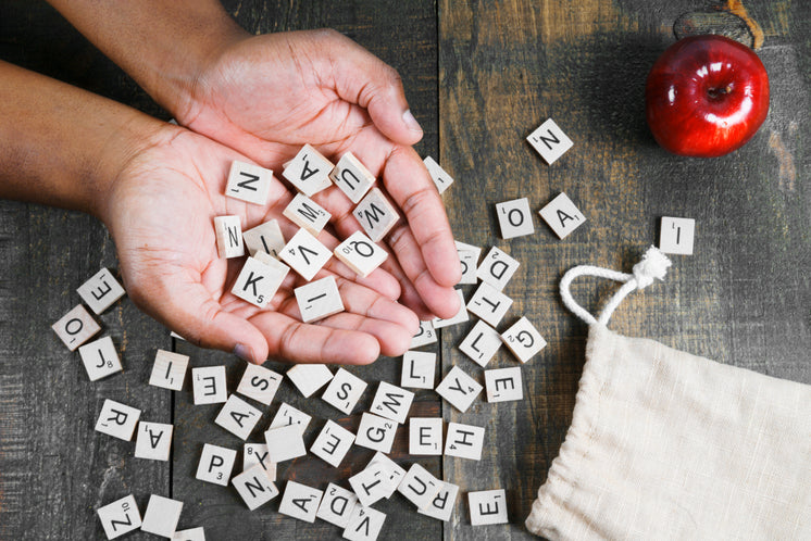 Spelling Game Letter Tiles In Hand