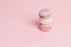 stack of pink macarons on pink right side