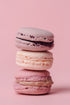 stack of pink macarons on pink
