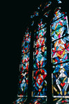 stained glass window panes in a gothic church window