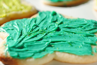 star cookie with green icing and sprinkles