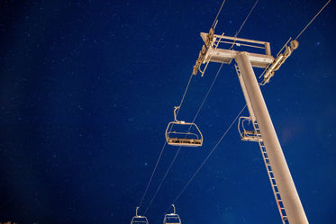 starry night sky and a chairlift