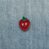 strawberry enamel pin denim