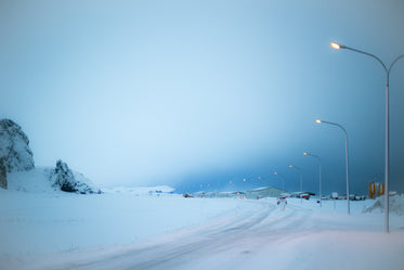 street lights glow in iceland winter