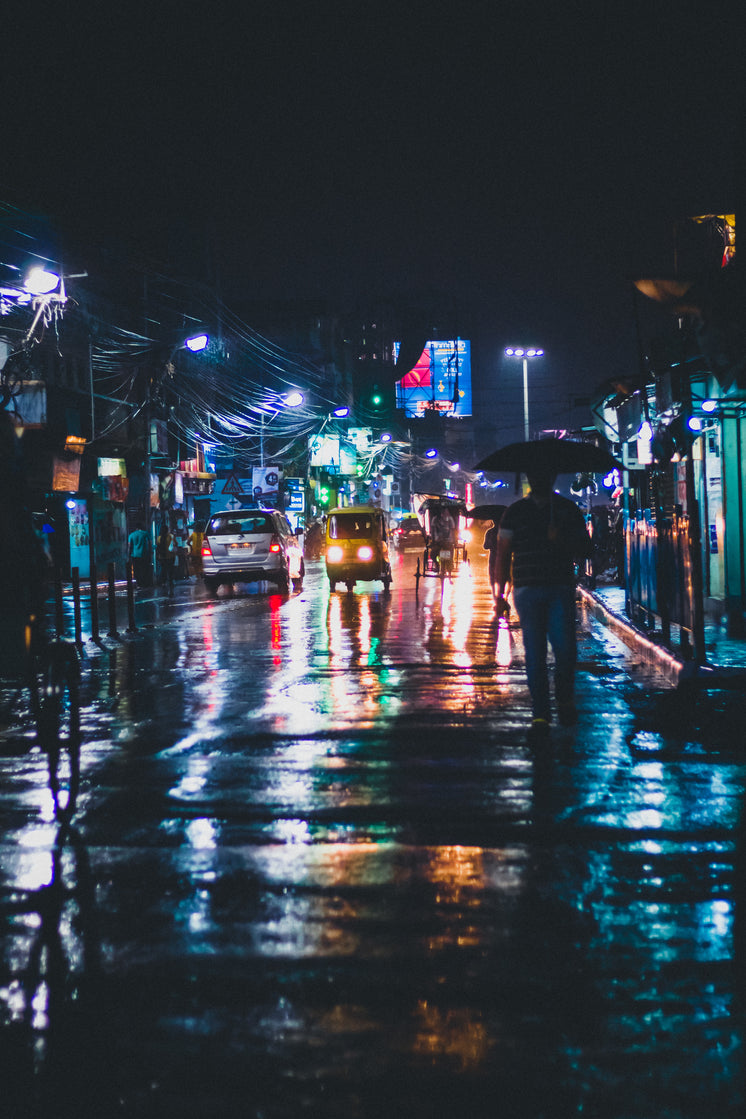 Street Lights Reflect On Wet City Streets In India