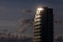 sun glinting off top of condo tower