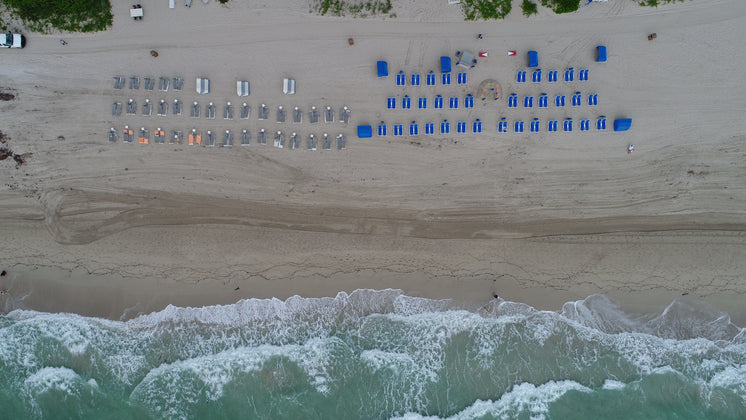 Sun Loungers Lined On The Beach