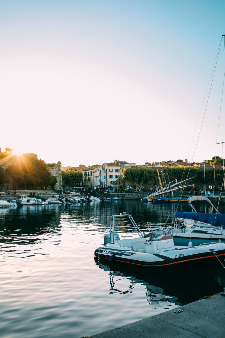 Sunset Over Boats In A Marina