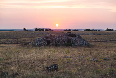 sunset over small pile of rubble