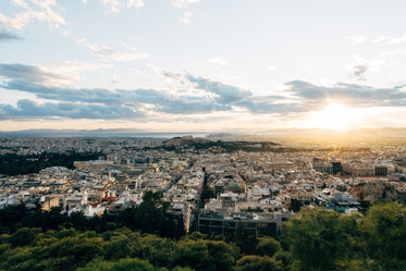 sunsets in an aerial view of a busy city
