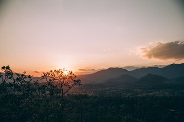 sunsets over thailand mountains