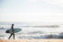 surfer carrying board