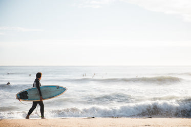 Picture of Surfer Carrying Board - Free Stock Photo