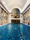 swimming pool with ornate ceiling and columns