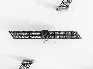 swing bridge locked in place in a frozen river surrounded by snow