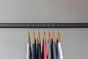 t shirts hanging on rack