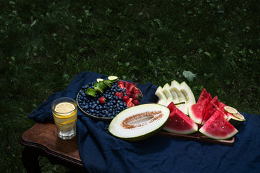 table outdoors with assorted fruits on it